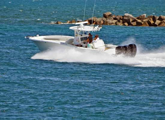 Sport fishing boat exiting Government Cut in Miami, Florida headed towards the open ocean