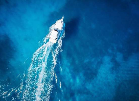 Overhead view of yacht in clear Caribbean water